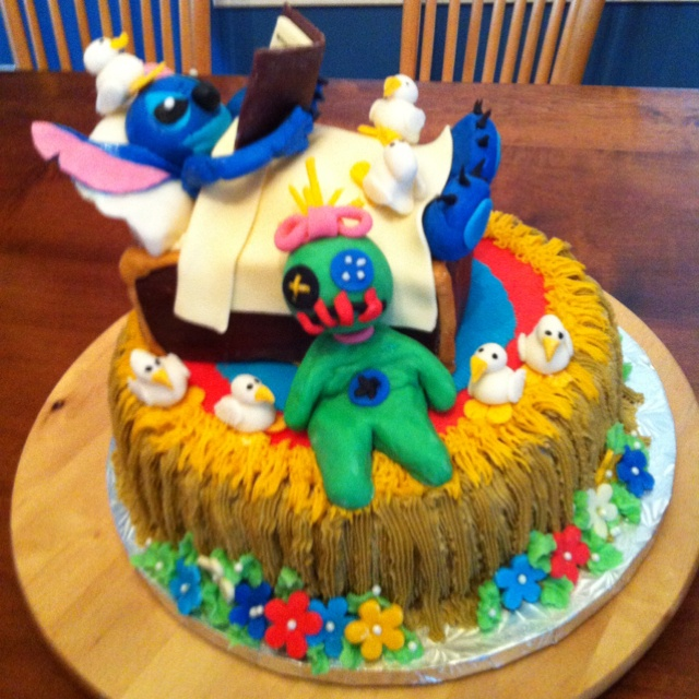 Katie's 8th Birthday Cake - Stitch (from Disney's Lilo and Stitch) in his bed made by Lilo reading the Ugly Duckling to his duckling friends and Lilo's Doll.  Katie loves it!!!