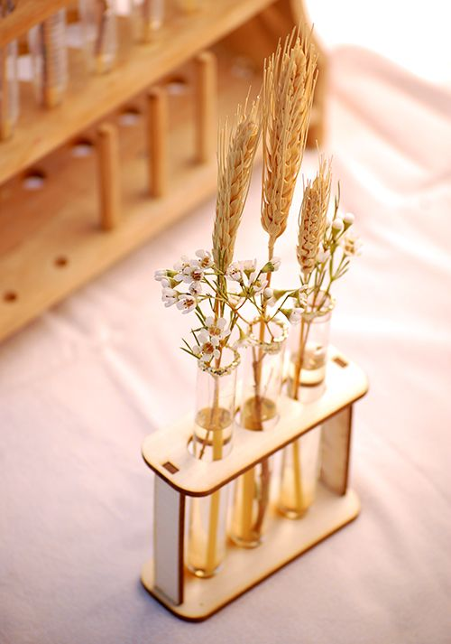wheat & wax flowers in pretty test tubes ::: wedding centerpieces #wheat #fall #harvest #centerpiece #testtube #waxflower