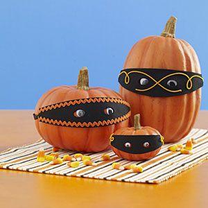 Masked pumpkins...too cute!
