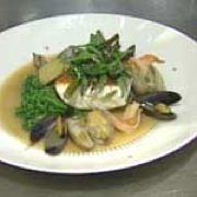 Pan-roasted halibut with cioppino broth, shellfish and seasonal veget ...