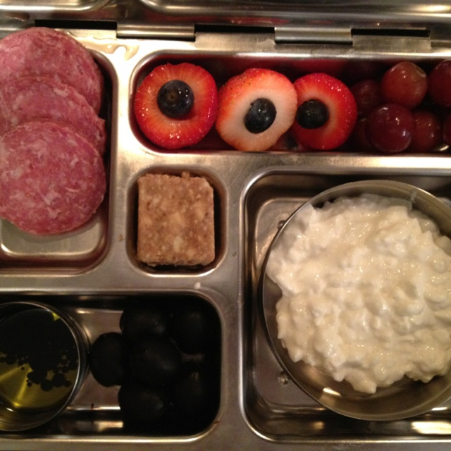 Genoa salami, olives with oil and vinegar dip, blueberry stuffed strawberries, grapes, cottage cheese, and cashew Lara bar