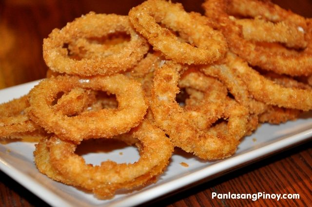 Onion rings are sliced onions that are dipped in a batter, and deep ...