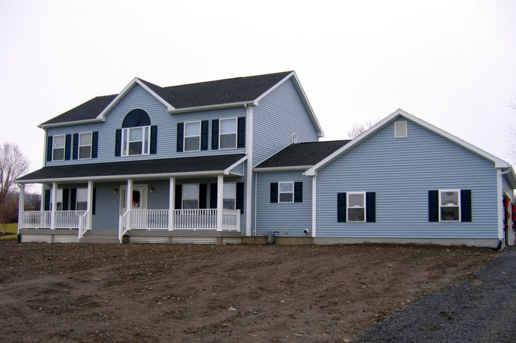 Blue siding black shutters new home exterior touches for Blue house builders