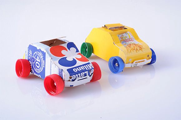 Recycled juice cartons and plastic bottle caps make perfect toy cars!