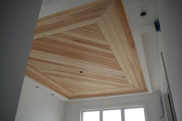 Master bedroom tray ceiling dark wood new home build Shiplap tray ceiling