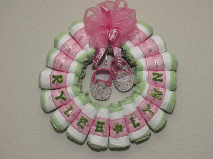 Small rolled baby girl diaper wreath for Diaper crafts for baby shower