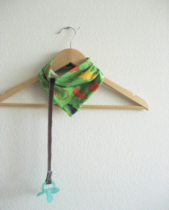 Clever: Bandana baby bib with an attached pacifier clip on Etsy