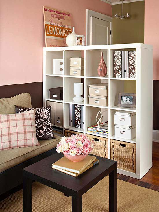 Apartment Storage for small spaces. I like this idea of using a shelving unit to separate the entry way from the living room