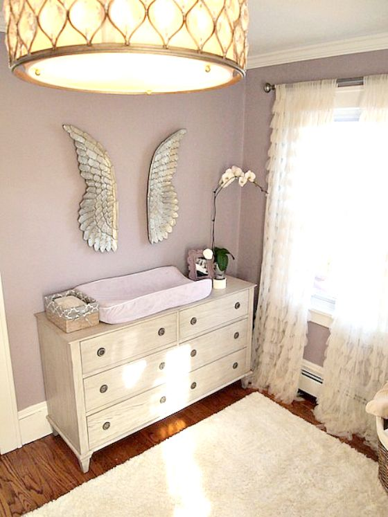 Glamorous Purple and Gray Nursery - how sweet are these silver angel wings?! #nursery #decor