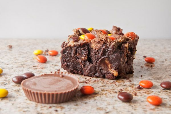 Fudgy, rich flourless triple chocolate brownies laced with peanut ...