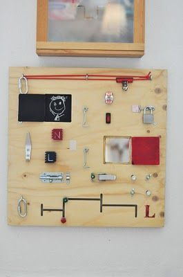 Activity board with hardware store parts