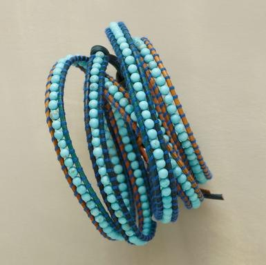 "Chan Luu lines up nearly 250 turquoise beads bordered with variegated leather, wrapped with complementary threads. Wraps five times, fastening with a sterling button-and-loop. 32""L."