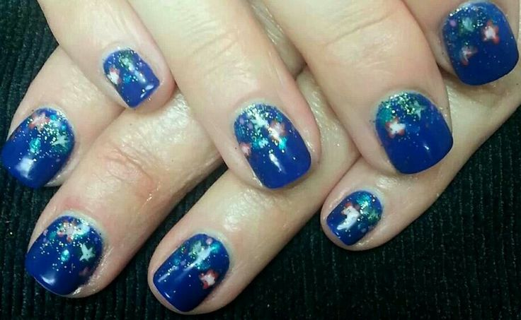 nail art on blue by Margene at Salon Revolution in Sioux Falls, SD
