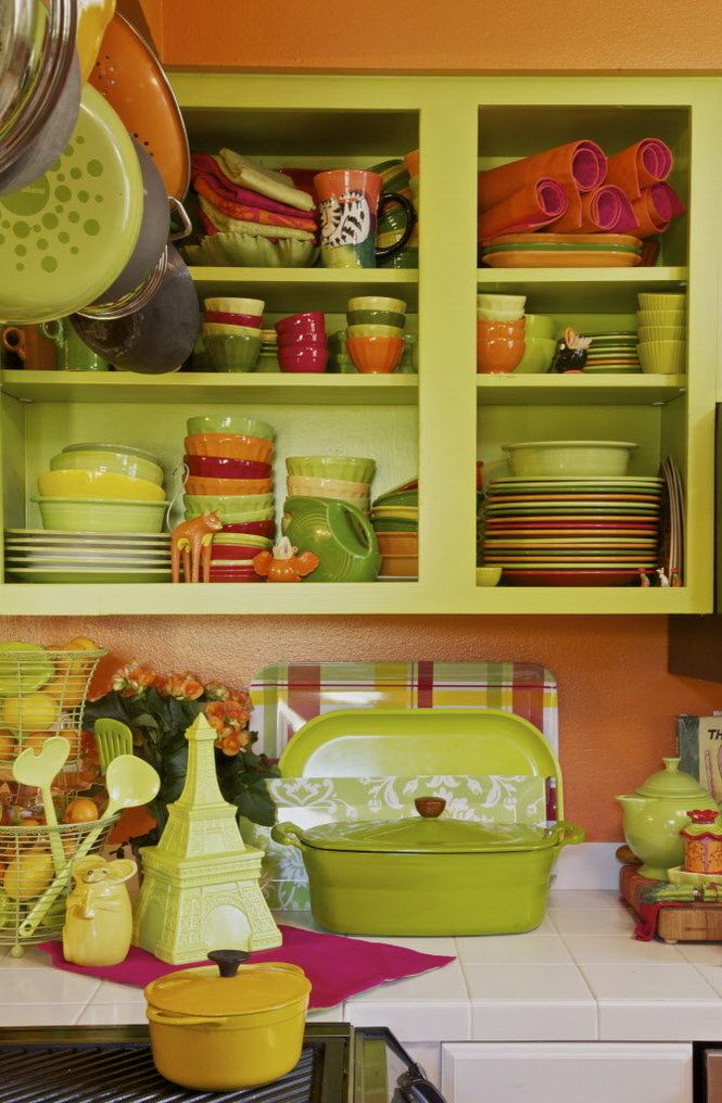 Lovely little green and orange kitchen. I wish all of my plates, bowls ...