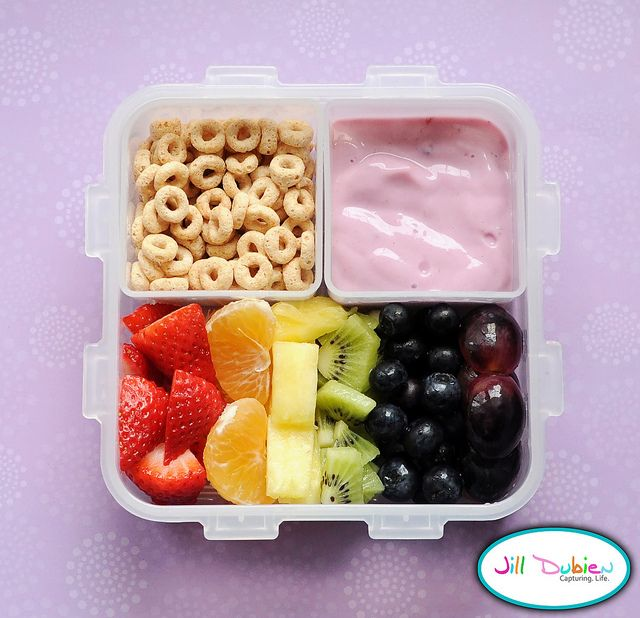 I just love how bright and colourful this rainbow bento turned out. She had a rainbow of sliced fruit, a container of cheerios, and a container of yogurt. It made for a perfect morning nutrition break meal.