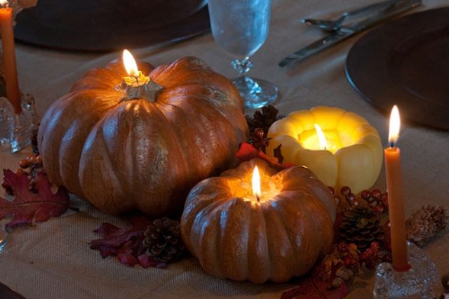 Pumpkin Candles make a bright and natural centerpiece for your Thanksgiving celebration. Gather a variety of medium and small pumpkins for the center of your table. Carve out around the stem of every one, filling each hole with a small votive or tealight.