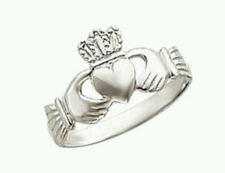 Are clasping the heart surmounted by a crown and symbolic of love