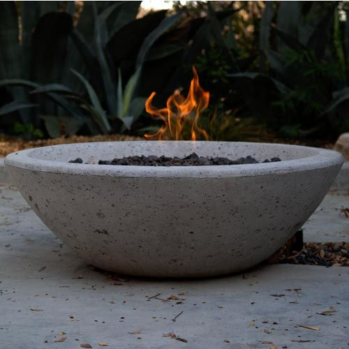 """Nothing brings a crowd together like a fire. Arrange a group of our hoop chairs around this contemporary Wok Fire Pit for a warm and inviting outdoor living room. Made of reinforced concrete in a natural cement finish, burn either wood or plumb to use with gas.     Sizes: Sm 33""""dia x 11""""h, Base is 16"""" dia (approx 175lbs), Lg 37""""dia x 13""""h, Base is 13"""" dia  (approx 255lbs)"""