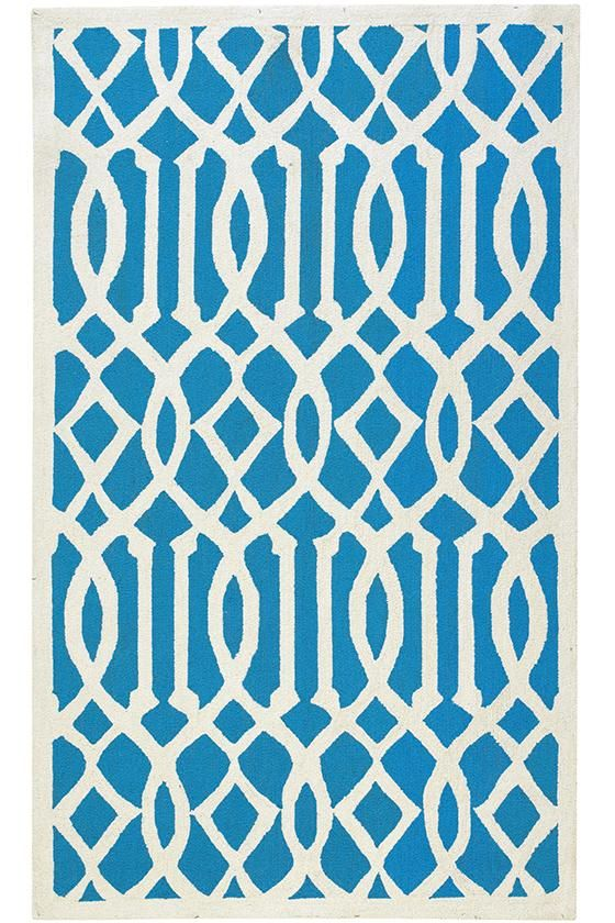 A turquoise and white patterned rug.
