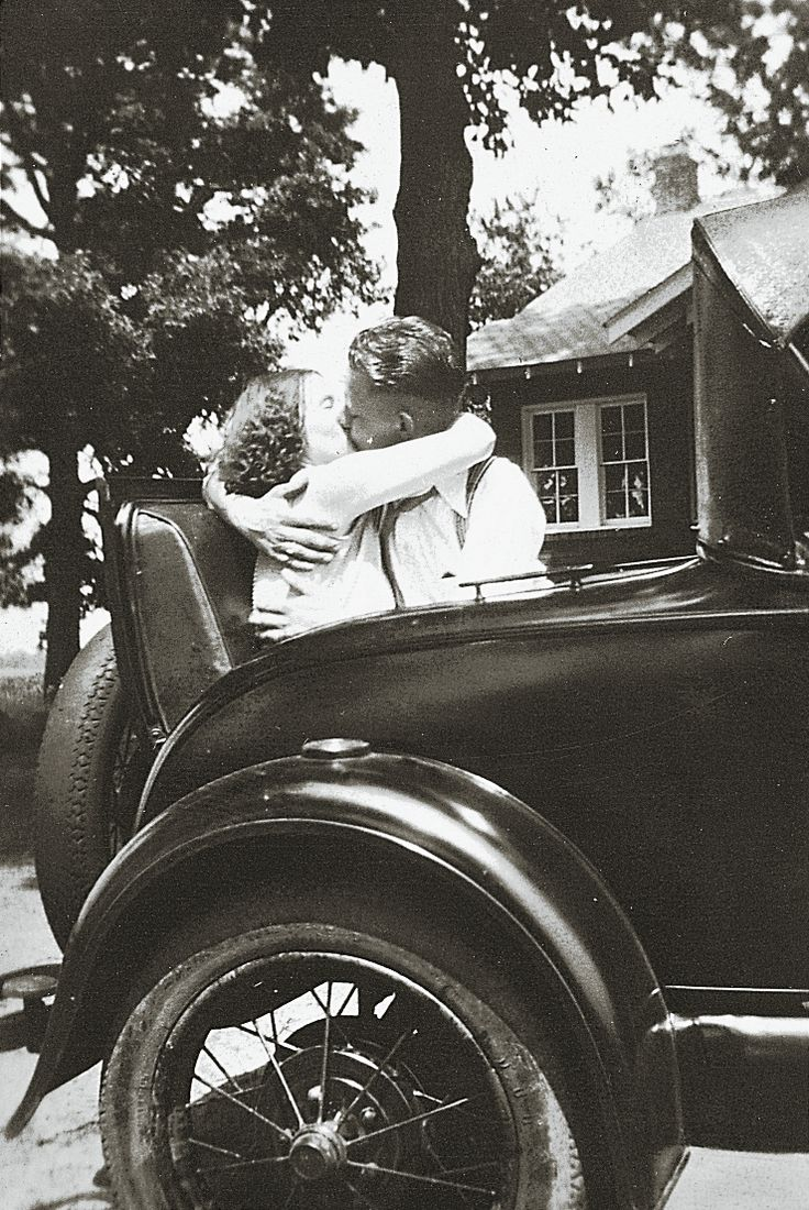 Esther and Fred Loge share a kiss in the rumble seat of their roadster in the 1930s (from Reminisce.com)