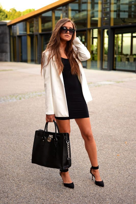 Mini skirt and black bag with black high heels