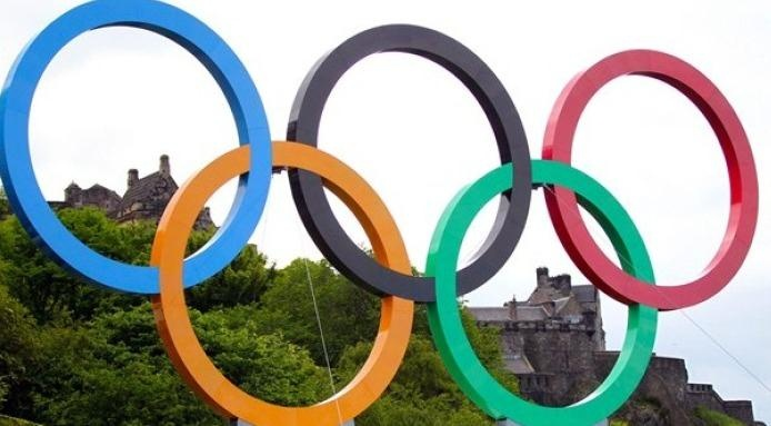 what does the olympic flag symbolize