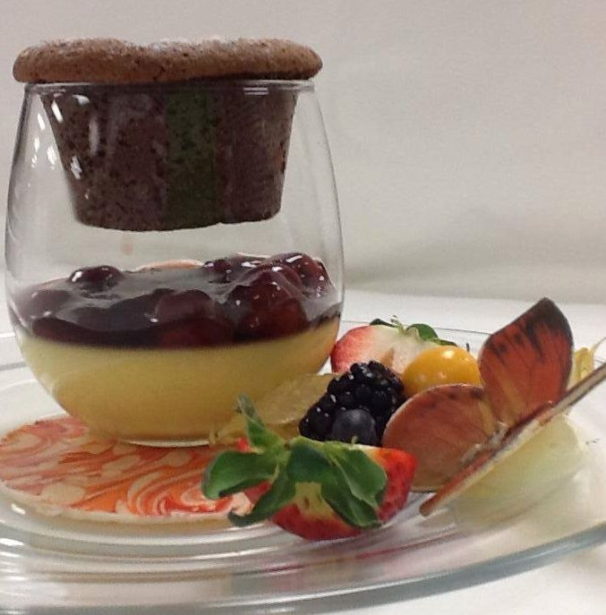 ... chocolate lava cake suspended over cherry brandied creme brulee