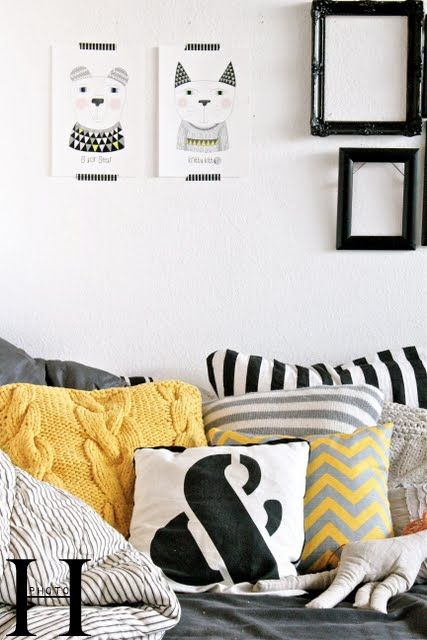 Yellow knitted pillow from HK living (from www.hallingstad.dk) and a pillow with zigzag pattern in yellow and gray (from www.kindbynature.dk). Prints on the wall are also from Kind by Nature.