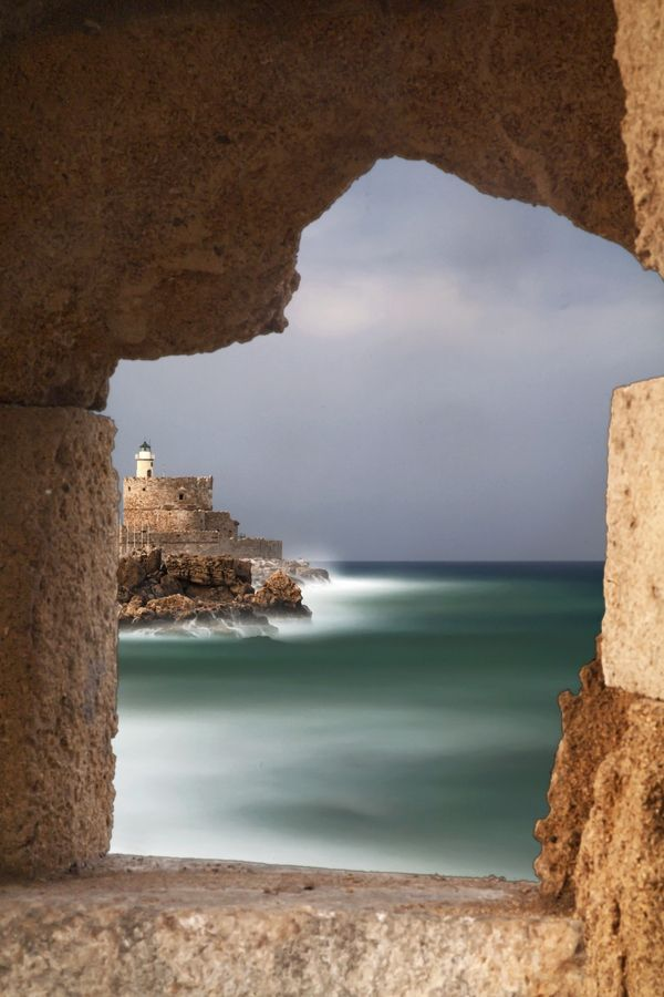 The lighthouse at the old port of the Greek island of Rhodes