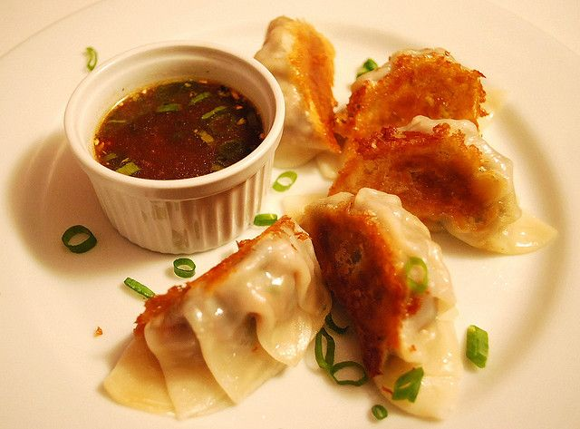 Pork and Shrimp Pot Stickers with Orange Ginger Dipping Sauce