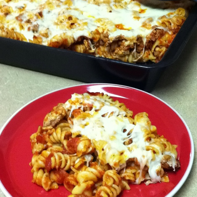 Baked pasta with ground turkey, Italian sausage topped with grated ...