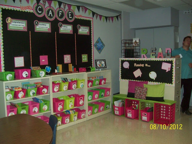 Love the organized classroom library and LOVE the crates on their sides with a cushion on top for seating!!