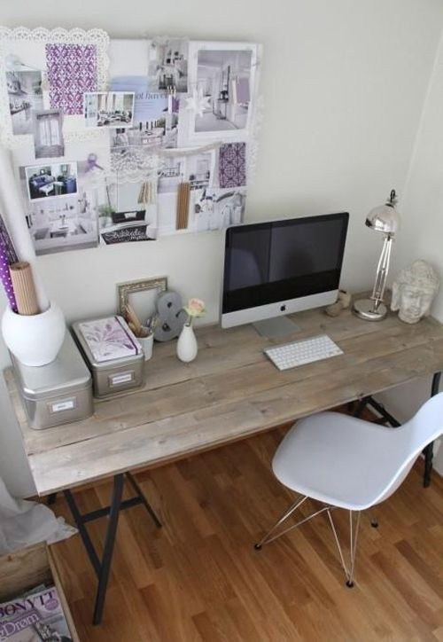 I chose this picture because I liked the simplicity of the office.  The cool colours mixed in with touches of purple make the room cool, yet have som colour to it.  Simple furniture give it a modern feel.  Horizontal desk harmonizes the items around it.