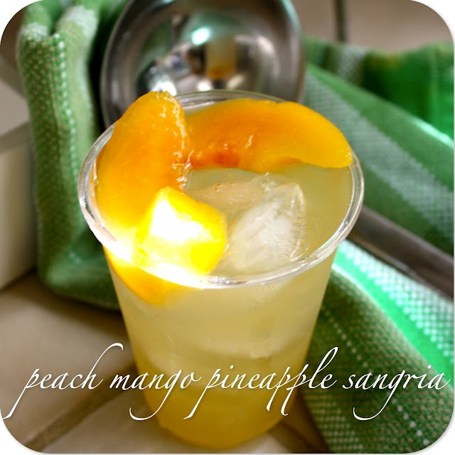 Peach, Mango, Pineapple Sangria- I want some now!!! Perfect drink to ...