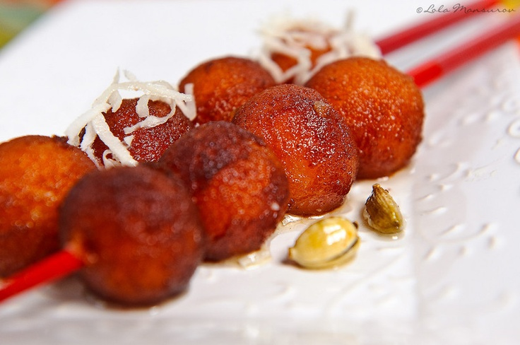 Indian Gulab Jamun-- like donut holes soaked in sweet syrup