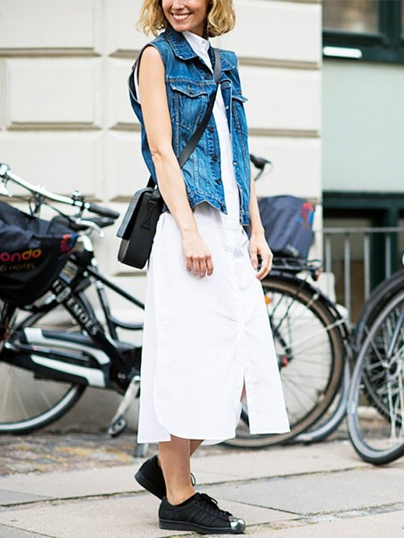 Give your simple white dress an uplift by layering a denim vest over it. // #Fashion