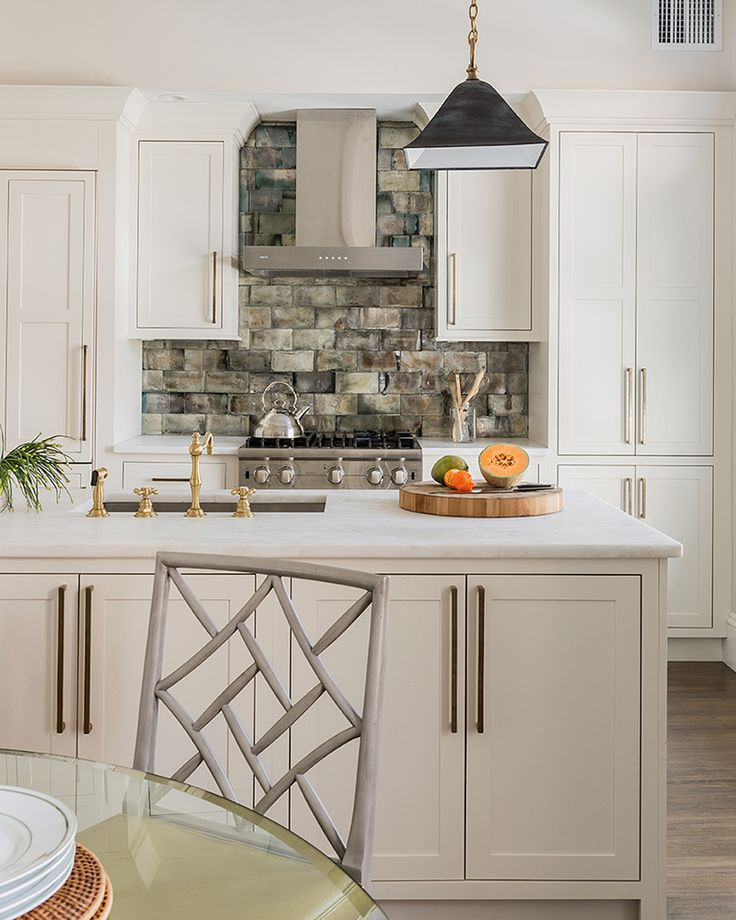 White cabinets stone brick backsplash kitchens pinterest for White kitchen cabinets with stone backsplash