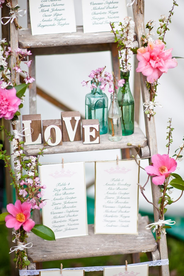 A tall step ladder hold the seating plan and quirky trinkets.