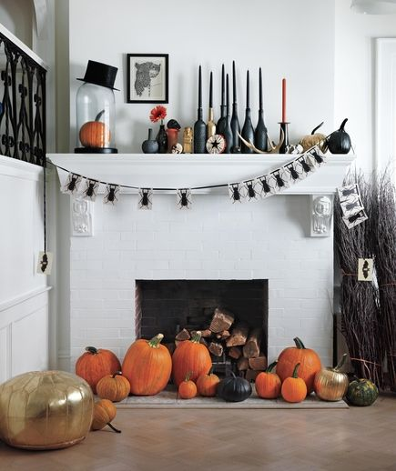 Easy DIY Halloween tip: Concentrate your decor efforts on the table and one other spot—like a mantel, a sideboard, or a deep windowsill—is just as effective (and a lot less hassle).