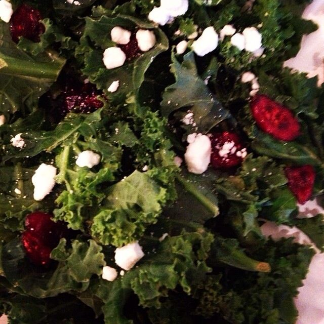 Salad of fresh kale, cranberries, goat cheese and pine nuts with ...