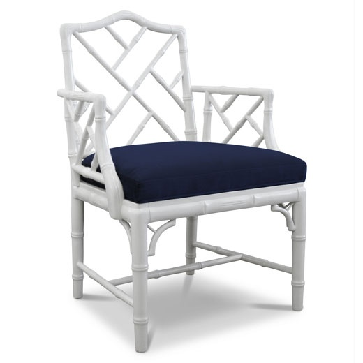 The white chippendale arm chair, by Jonathan Adler.