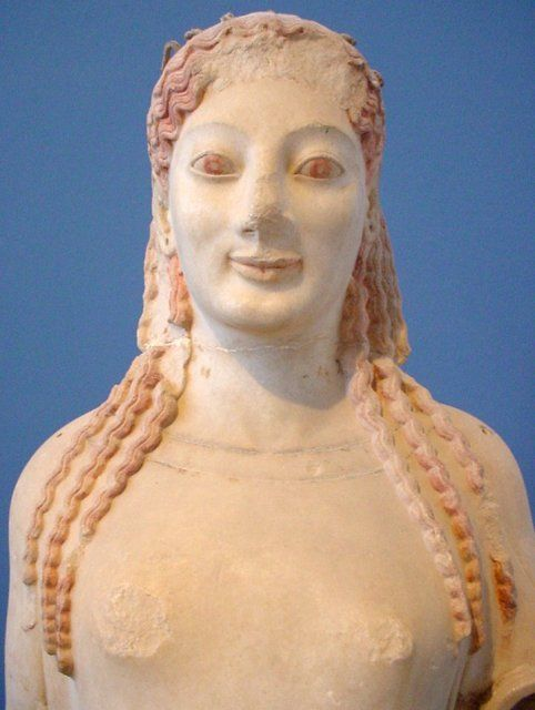 the peplos kore The peplos kore statue of a young woman (kore) clad in a chiton and peplos, which was originally ornamented with painted decoration traces of paint are still visible on her eyes, lips and curly hair, which was held by a metal diadem.