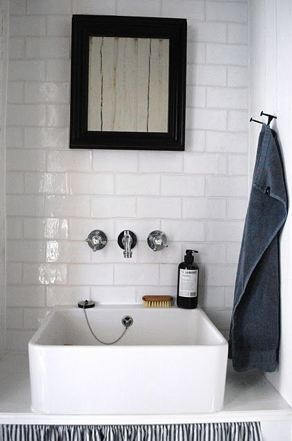tiled wall & square raised sink.