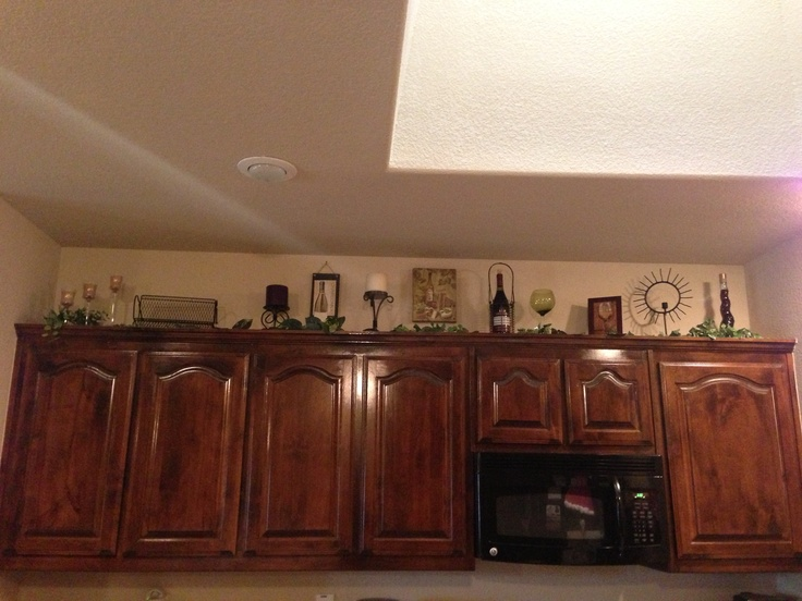 Above kitchen cabinets decorating my house pinterest - Pinterest kitchen cabinets ...
