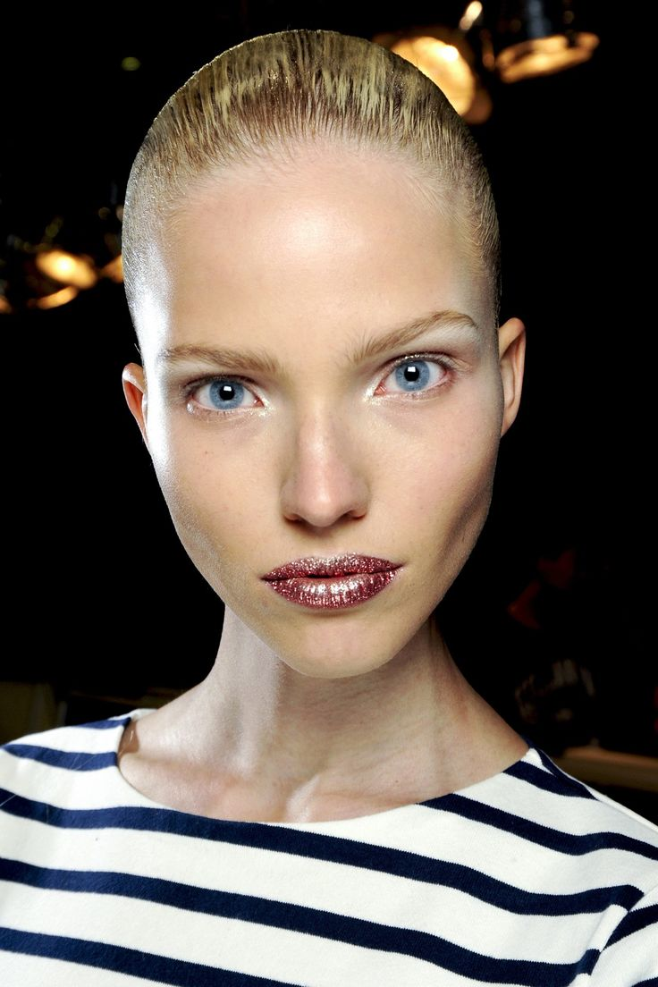 Couture Beauty: Autumn/Winter 2013-14 | Christian Dior / Hair was slicked into sleek, low chignons.