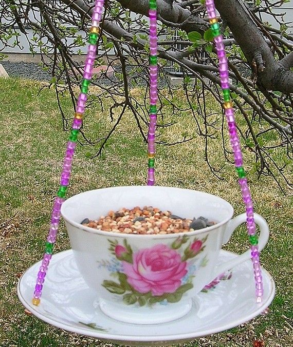 But I'd put water in the tea cup and bird seed in the dish. I love the beads though!