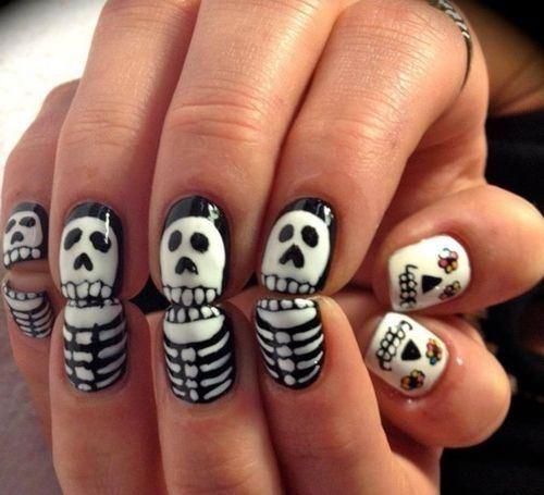 Skull & bones nail art | halloween ideas | Pinterest