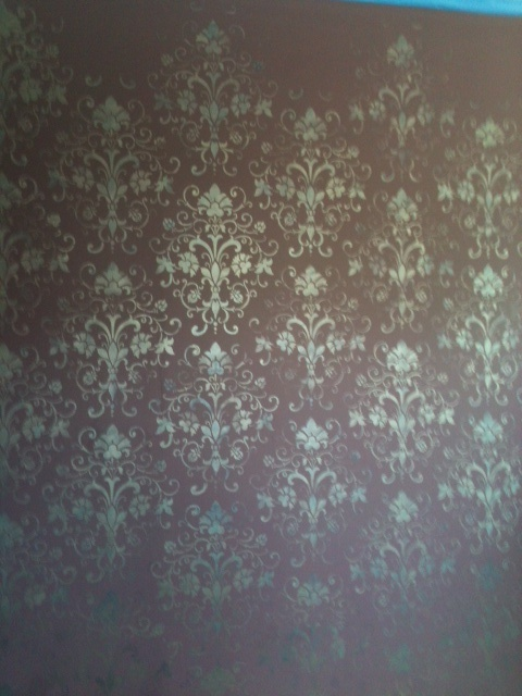 my stenciled damask wall in silver with blue glitter paint accents. Black Bedroom Furniture Sets. Home Design Ideas