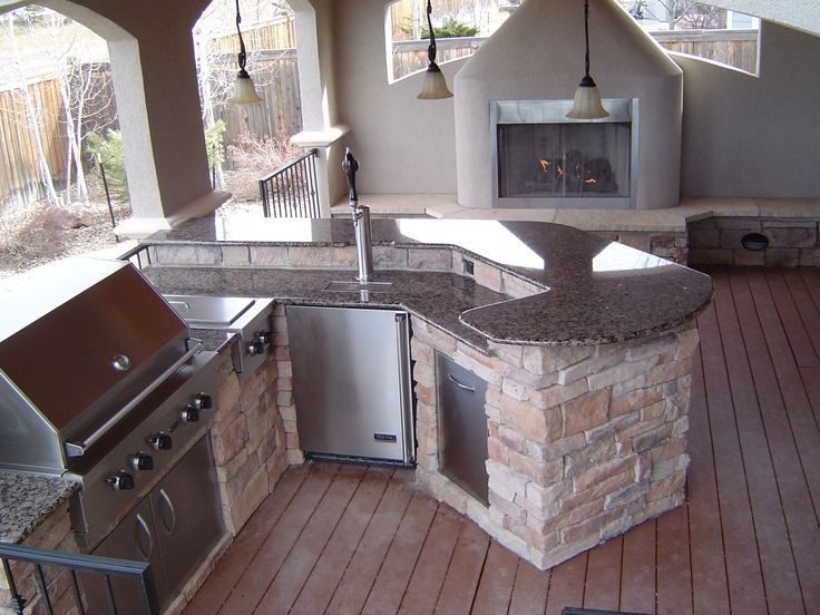 Outdoor kitchen fireplace my home will have this pinterest