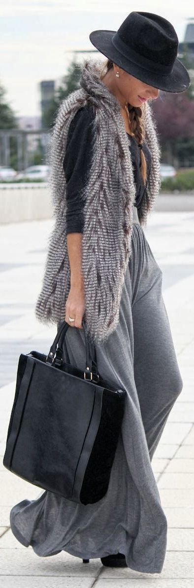 Busy days call for a simple yet stylish outfit, such as a grey fur vest and a grey maxi skirt. Elevate your getup with black suede ankle boots.  Shop this look for $114:  http://lookastic.com/women/looks/hat-long-sleeve-t-shirt-vest-maxi-skirt-tote-bag-ankle-boots/4858  — Black Wool Hat  — Black Long Sleeve T-shirt  — Grey Fur Vest  — Grey Maxi Skirt  — Black Leather Tote Bag  — Black Suede Ankle Boots